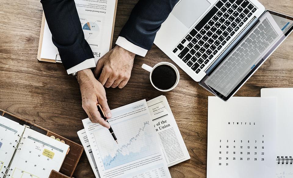 free photo action plan paper document business laptop