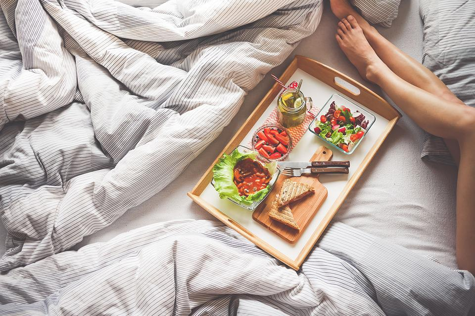 Adult, Bed, Bread, Chopping Board, Comforter, Drink