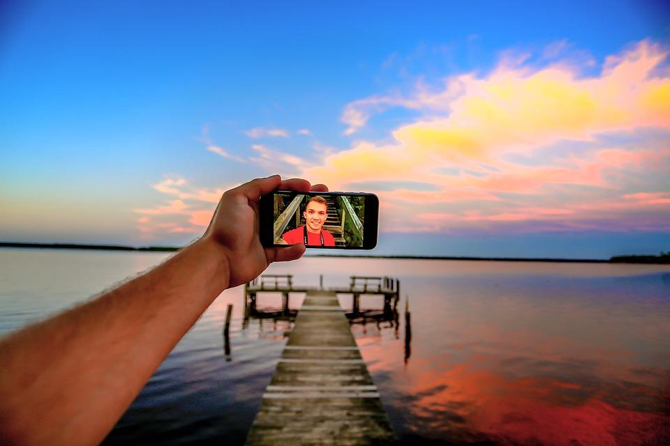 Free photo Beach Camera Clouds Close-up Cellphone Blur Arm - Max Pixel