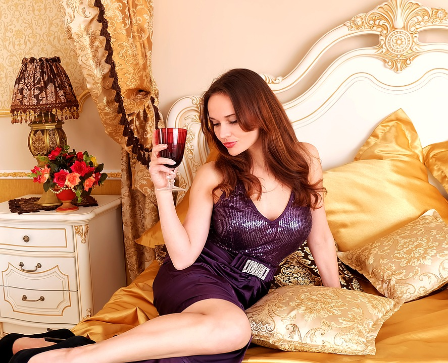 girl woman bed bedroom pillows glass room dress