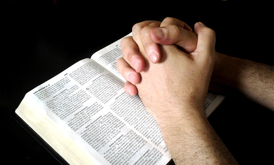 Interlocking Hands, Prayer, Bible