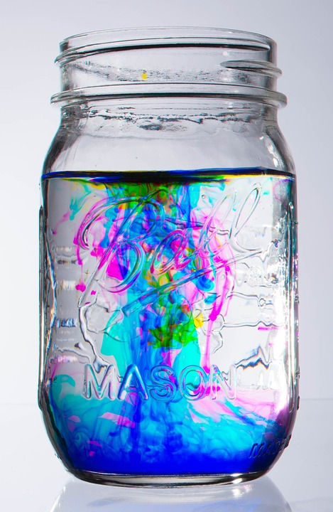 Free photo Blue Food Coloring Swirl Water Glass Jar Abstract - Max ...