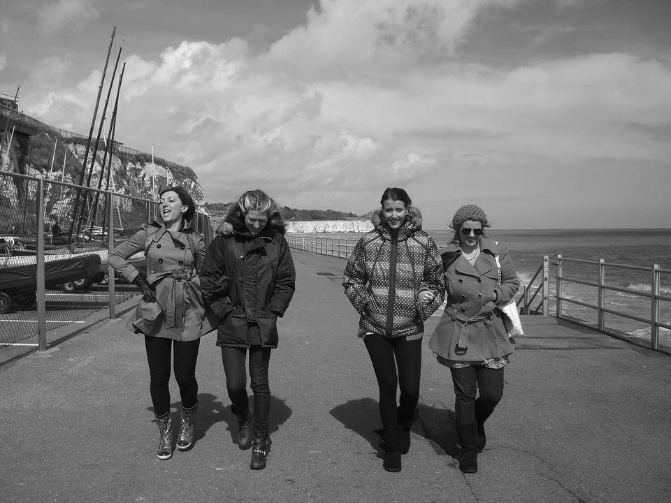Girls black and white coast uk beach walking