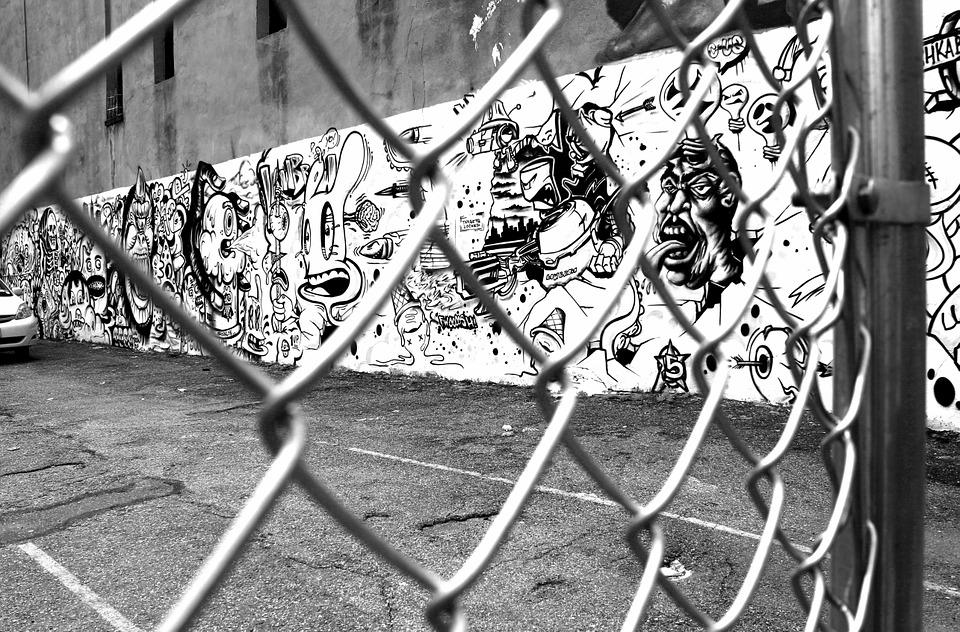 Graffiti wire mesh fence black and white street art