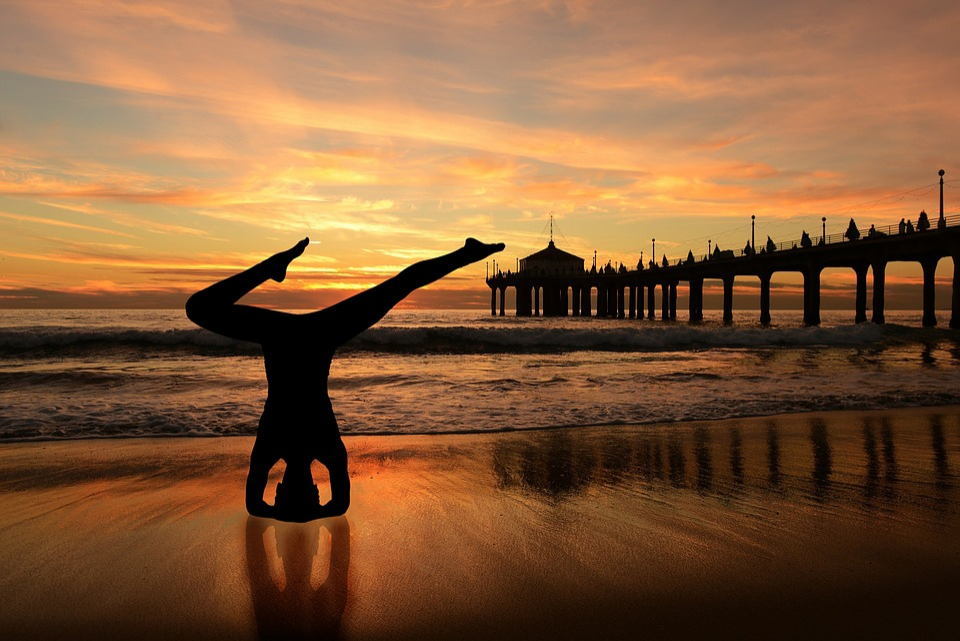 Headstand Yoga On The Beach Sunset Orange Sky