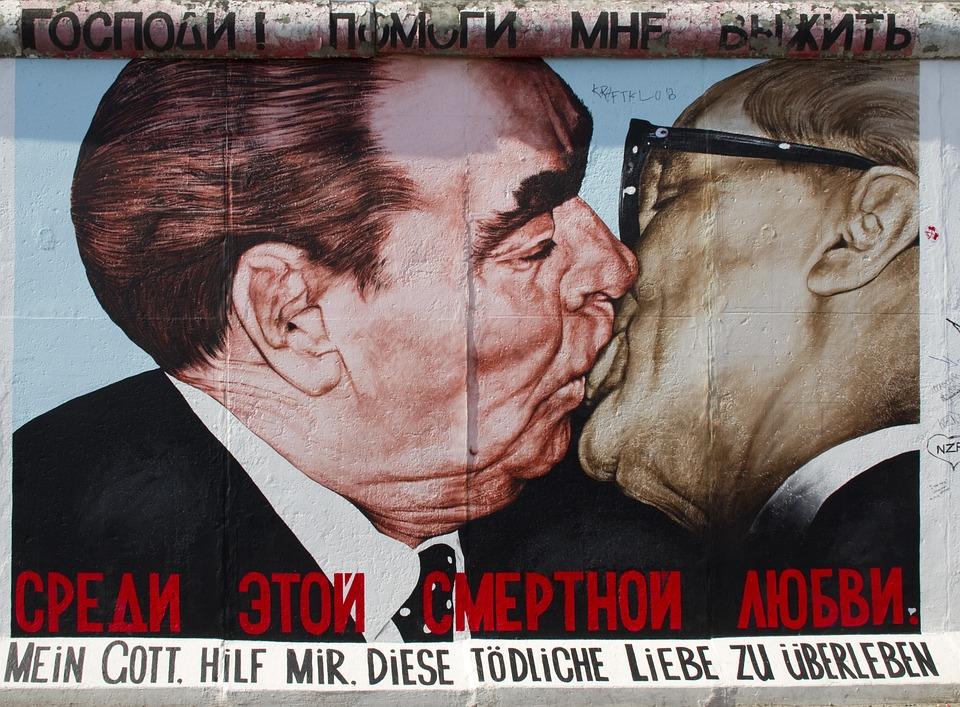 Reunion, Judas, The Berlin Wall, Irony