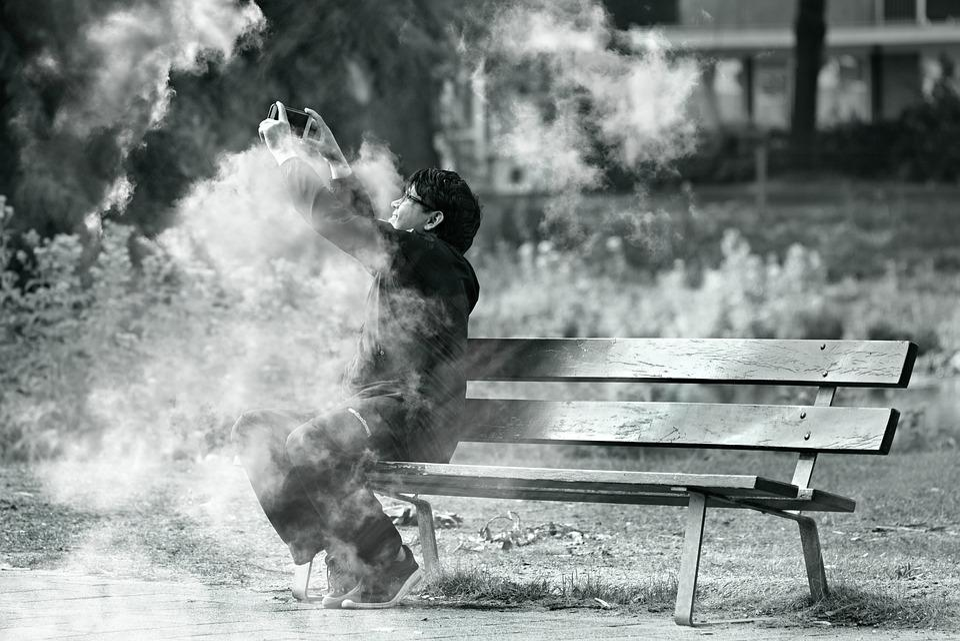 Man, Sitting, Bench, Taking Picture, Smoke, Fire