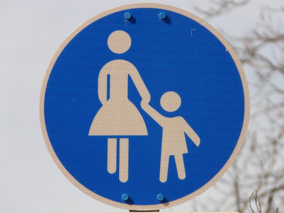 Sidewalk, Traffic Sign, Pedestrian, Shield, Woman