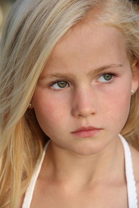 free photo portrait blonde green eyes girl seriously