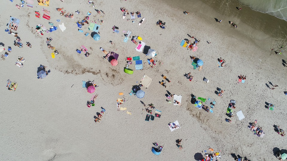 People Crowd Aerial Umbrella Tan Sunny Day