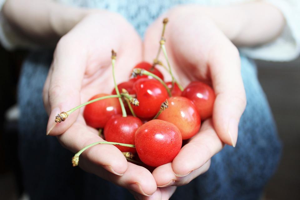 Clean Hands holding cherries