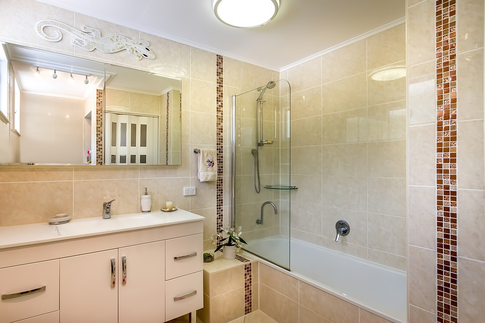 Free photo Tiled Bathroom Wall Tiles To The Ceiling Beige Tiles ...