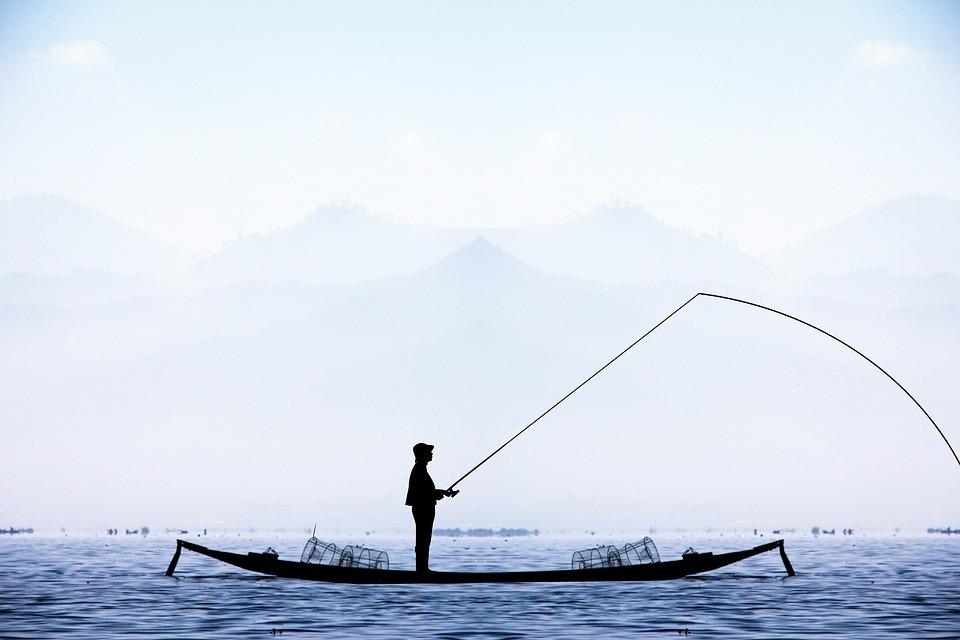 free photo winter fishing fisherman lake water blue boat max pixel