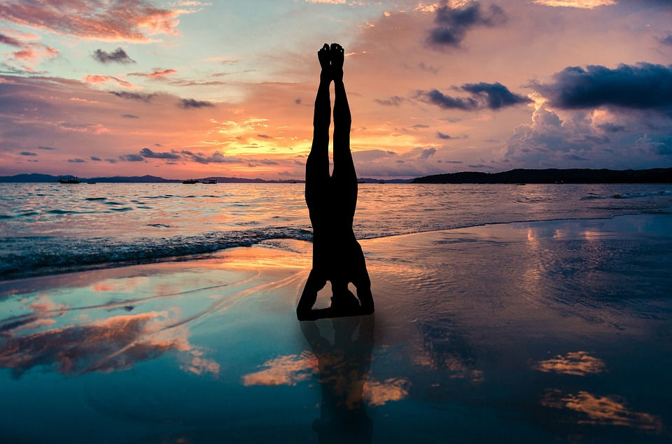 Yoga Stand In Hands Silhouette Sunset Beach