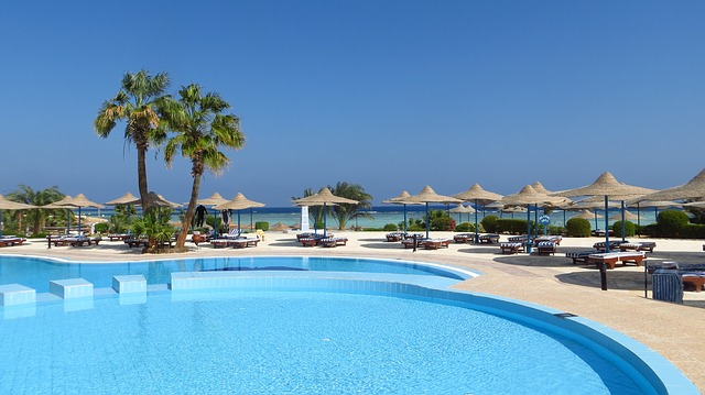 Pool, Palm Trees, Hotel, Tables, Umbrellas, Deck Chairs