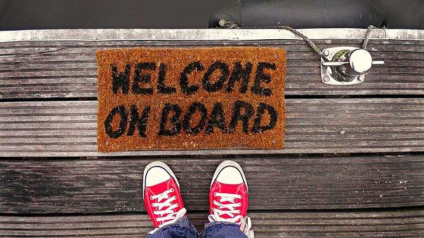 Dock, Feet, Footwear, Jetty, Mat, Shoes, Sign, Sneakers