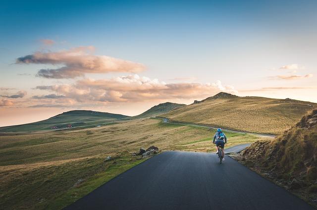 Cropland, Cyclist, Grass, Grassland, Hills, Landscape